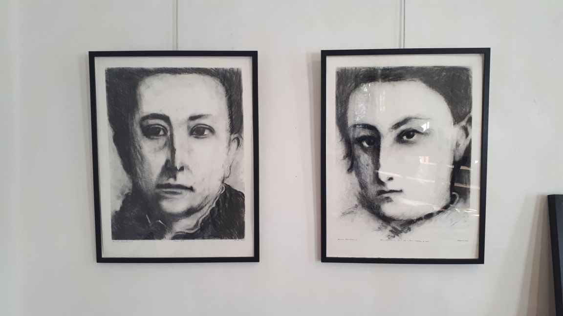 Two of the drawings in the gallery space.